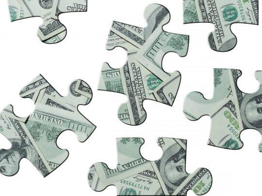 geld puzzelstukken
